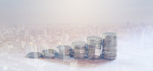 Rows of Thai coins with city background, finance and banking concept
