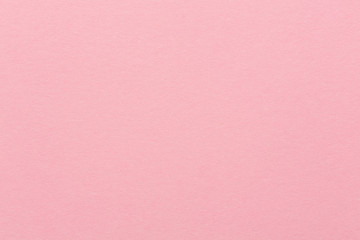 Soft pink paper texture for background usage.