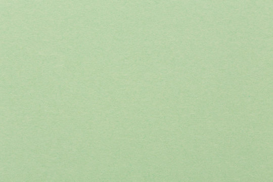 Light green paper background, colorful texture.