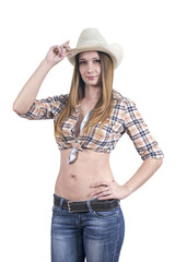 The young girl is a cowboy wearing a cowboy hat, jeans and plaid shirt. Isolated on white.
