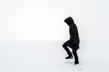 Woman walking in a snowy field