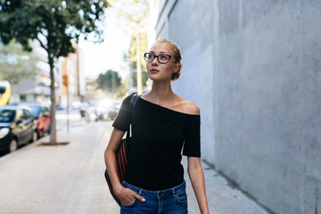 Portrait of a blond woman in the city