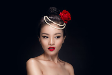 Fashion studio shot of beautiful young asian woman with retro ha