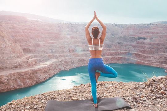 Girl training yoga pose outdoor