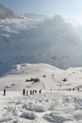 Ski slope avalanche covered with skiers around