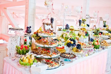 Wedding reception. Table with fruits and sweets