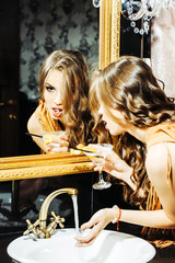 Pretty girl looks in mirror