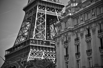 An old and classic building around the Eiffel tower