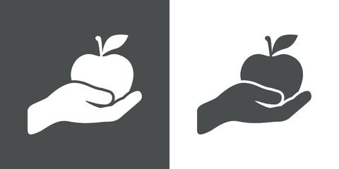 Icono plano mano con manzana gris