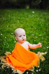 Little girl in an orange plaid
