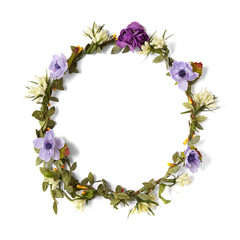 A purple paper flower crown isolated on a white background