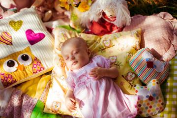 gorgeous little girl lying on the coverlet