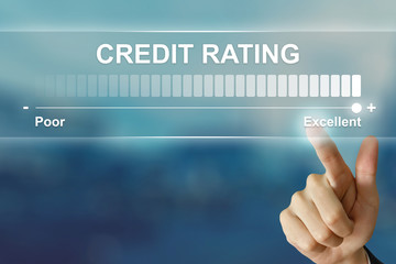 business hand clicking excellent credit rating on virtual screen