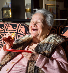 Smiling woman eating a slice of bread