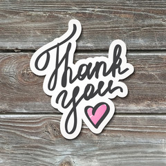 thank you, lettering with heart, handwritten text, paper sticker on realistic wood texture