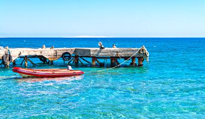 rubber boat near the pier in the sea