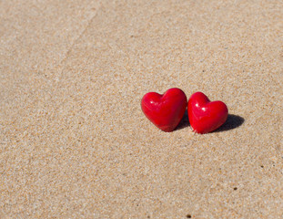 Red hearts on the beach. Couple in Love Valentines Day concept.