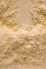 Background with a solid surface  Italian cheese texture
