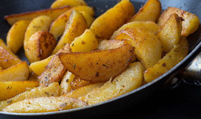 potatoe wedges in a pan