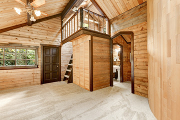 Wooden house interior with round wall and carpet floor