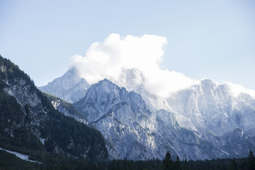Mountains covered with white clouds under blue sky from Planica