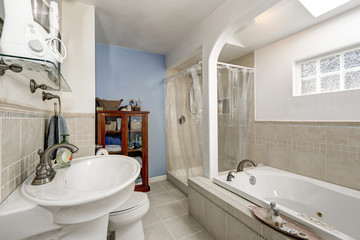 White clean bathroom with beige tile trim and small window
