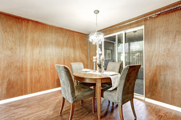 Wooden interior of dining room with romantic table setting