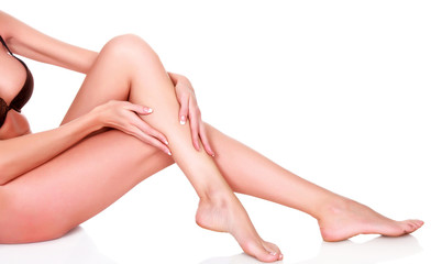 Woman's legs and hands, isolated on white background