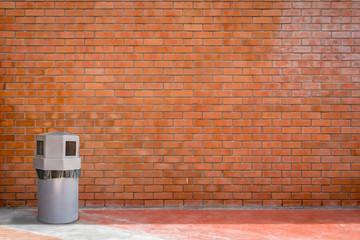 Trash can and brick wall