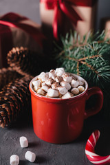 Hot chocolate or cocoa with marshmallows on gray background. Christmas presents. Holiday concept.