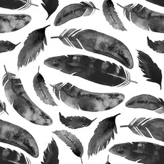Watercolor seamless pattern with black feathers on white