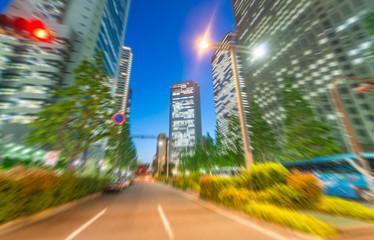 Blurre view of Shinjuku street at night from moving car
