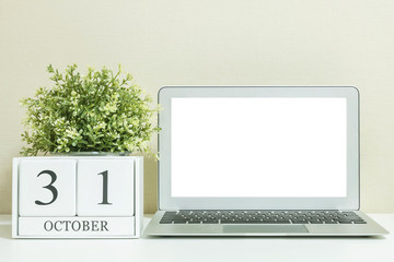 White wooden calendar with black 30 october word with white blan