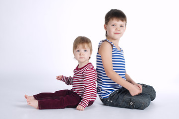 two funny siblings portraits on white background