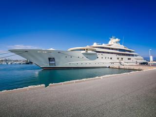 Gigantic big and large luxury mega or super motor yacht at dock