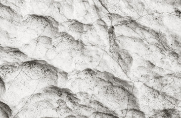 Closeup surface of stone pattern at big rock for decoration in the garden textured background in black and white tone