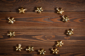 Christmas toys golden stars  on  wooden background concept Chris