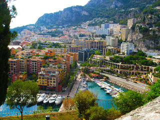 Panoramic view of Port de Fontvieille in Monaco. Azur coast. Colorful bay with a lot of luxury yachts in sunset.