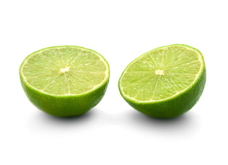 two halves of lime isolated on white background