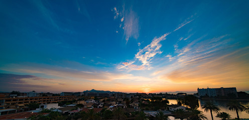 alcudia mallorca sunset over city