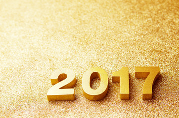 Fototapete - Closeup gold wood 2017 on glitter background, New year decoration. copy space