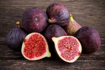 Fresh Figs slice on wooden table background