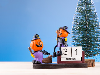 pumpkin toy figures playing on calendar date of 31 Octorber