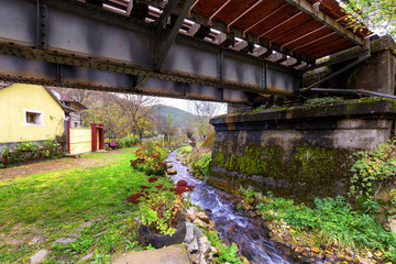 Mountain small river flowing free under the bridge