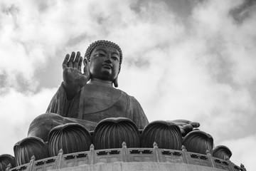Tian Tan Buddha (Big Buddha) statue in black&white at Ngong Ping on Lantau Island in Hong Kong, China, viewed from below.