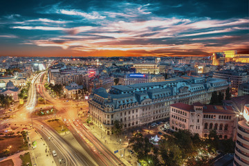 Aerial view of capital city Bucharest, Romania. University Square at sunset with traffic lights. Wall mural