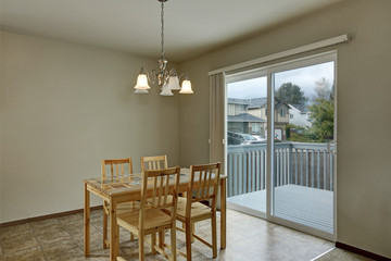 Dining area with wooden table and chair set. House interior