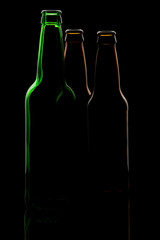 Silhouette of three different bottles