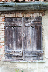 Old vintage windows with window shutters.
