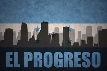 abstract silhouette of the city with text El Progreso at the vintage honduras flag